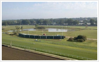 Three acre racetrack infield lagoon.